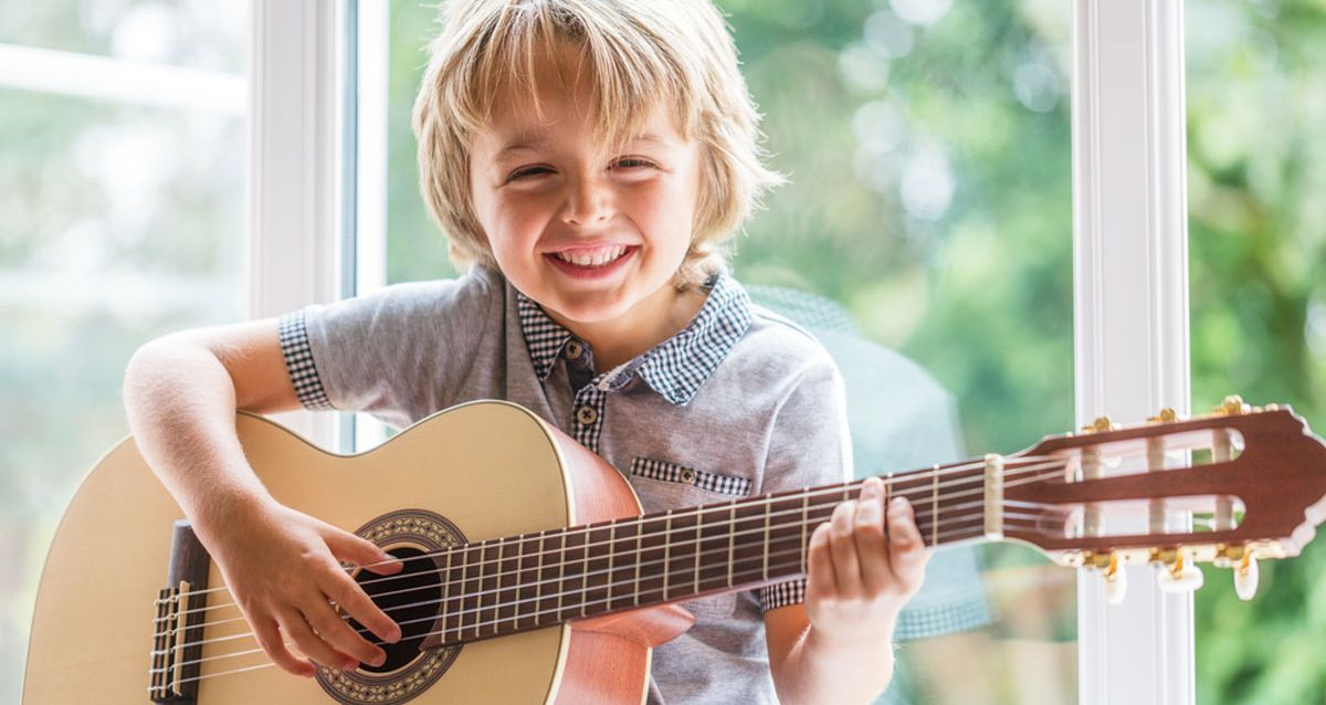 lessons-young-7-year-old-learning-from-guitar-instructor-3.jpg